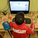 Hungarian kid 3D modeling on a computer
