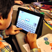 kid with the design process on his iPad