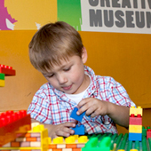 boy building at the Creativity Museum